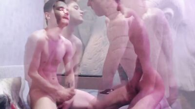 Two horny gay twinks are flip fucking on the floor